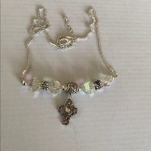Silver cross with charm necklace